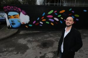 Ravenswood mural with artist
